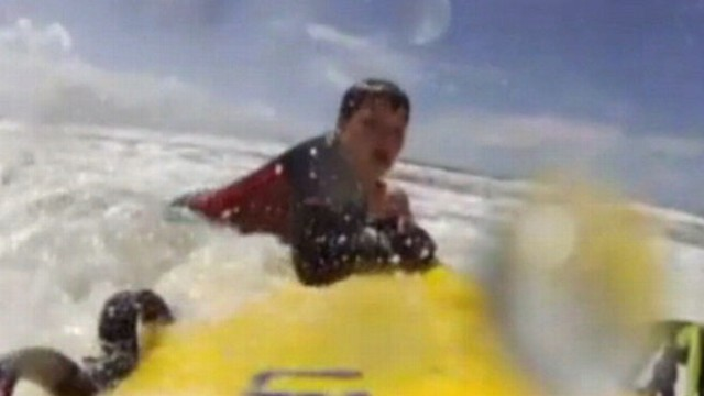 VIDEO: Lifeguards dramatic rescue of British boy is captured by surfboard camera.