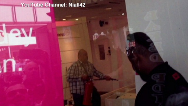 VIDEO: London customer rips displays off wall, sprays fire extinguisher inside store.