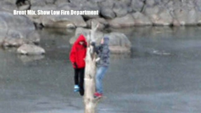 VIDEO:Two Arizona teenagers are rescued by firefighters as ice cracks beneath them.