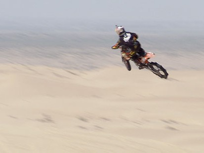 VIDEO: The worlds best motorbike riders catch air on the southern Calif. sand dunes.