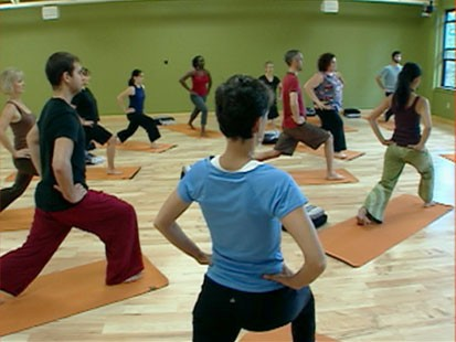A picture of people doing yoga.