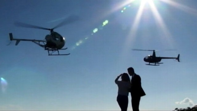 VIDEO: Girlfriend surprised with epic proposal after taking helicopter ride to mountaintop.