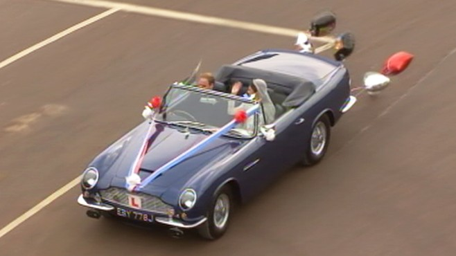 VIDEO: Prince William and Kate Middleton depart Buckingham Palace in an Aston Martin.