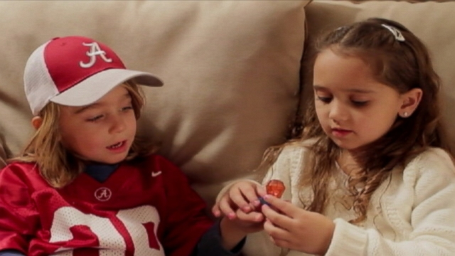 "Two kids reenact one couples relationship in awesome ""Save the Date"" wedding video."