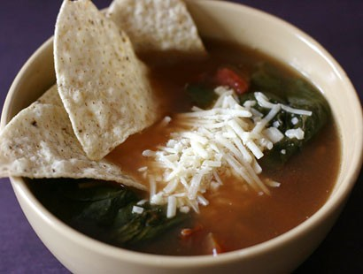 PHOTO: Stephanie ODea prepares a vegetarian tortilla soup