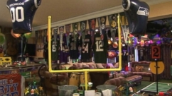 David Spiller decks out his guest house with NFL memorabilia, fake snow, a fog machine and laser lights.