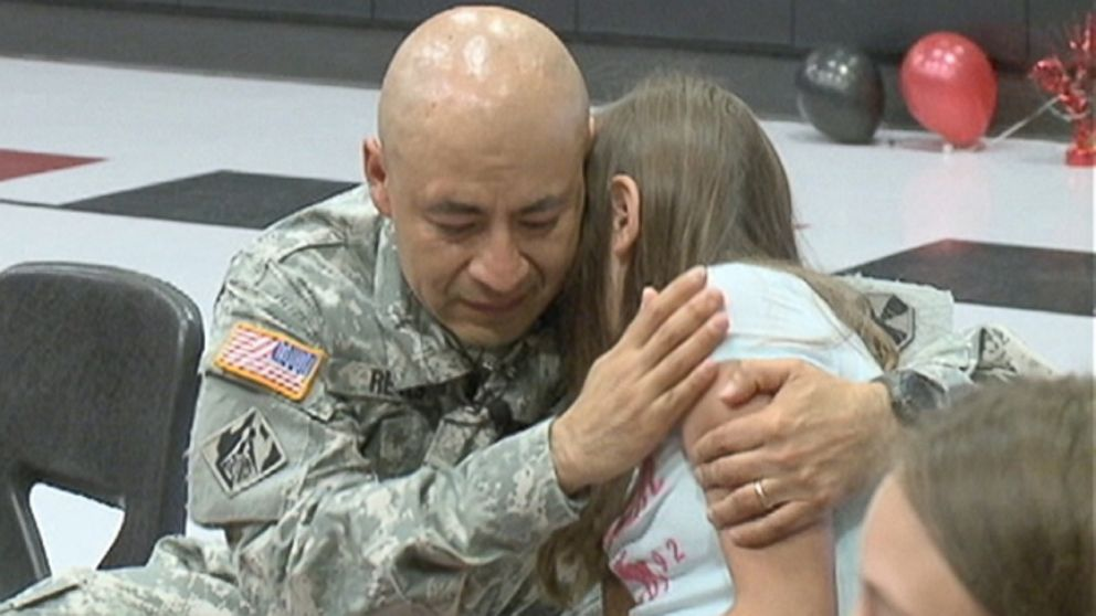 Maj. Julian Reyes delivered his fifth-grade daughter her diploma after not seeing her in nearly a year.