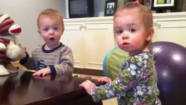 VIDEO: Twin 21-month-old babies Eliana and Evan love dancing to their musical monkey toy.