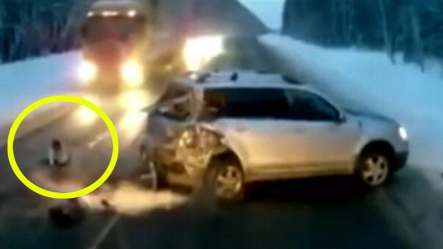 VIDEO: The Russian toddler survived the fall and barely escaped being hit by an oncoming truck.