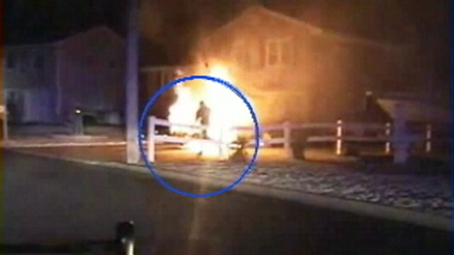 VIDEO: Officers in Barnegat, N.J., fought flames to save a trapped driver.