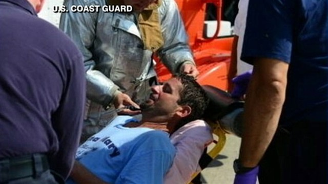 VIDEO: The U.S. Coast Guard rescued John Aldridge, 45, who used his rubber boots to stay afloat.