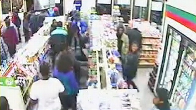 VIDEO: About 50 teens descended on a 7-11, grabbing items before fleeing the store.