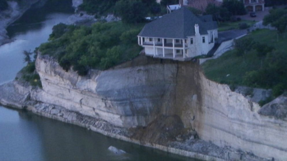 VIDEO: A portion of the Texas home has already fallen onto the shoreline of Lake Whitney.
