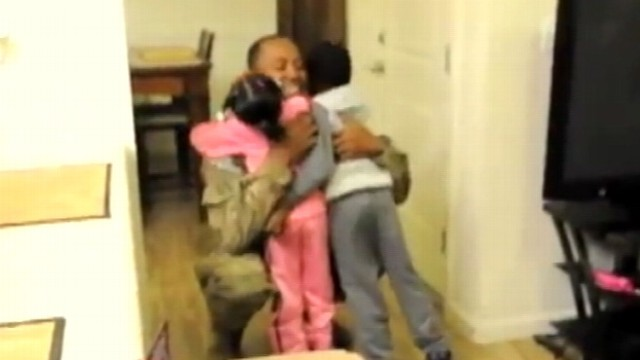 VIDEO: Dad serving in Afghanistan walks in on family Skyping with him.