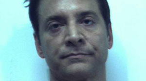 James Arthur Ray seen in his booking photo from Feb. 3, 2010, when he was arrested and charged with three counts of manslaughter connected to the deaths at an Arizona sweat lodge in October 2009.