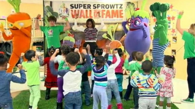 The first lady stretched and danced with suburban Washington school kids to promote a healthy lifestyle.