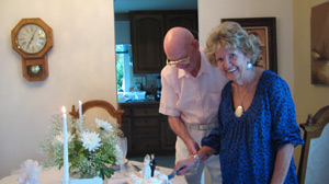 The couple cuts the cake: Fontelle and Robert Harrod on their wedding day, July 1, 2009