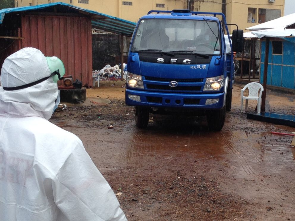 PHOTO: A truck comes to collect bodies from a makeshift Ebola ward in Monrovia, Liberia.