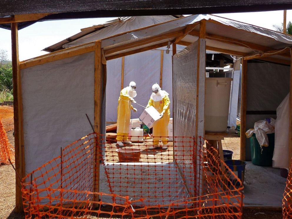 PHOTO: In this photo provide by MSF, Medecins Sans Frontieres, taken March 28, 2014, healthcare workers from the organisation prepare isolation and treatment areas for their Ebola, hemorrhagic fever operations, in Gueckedou, Guinea.