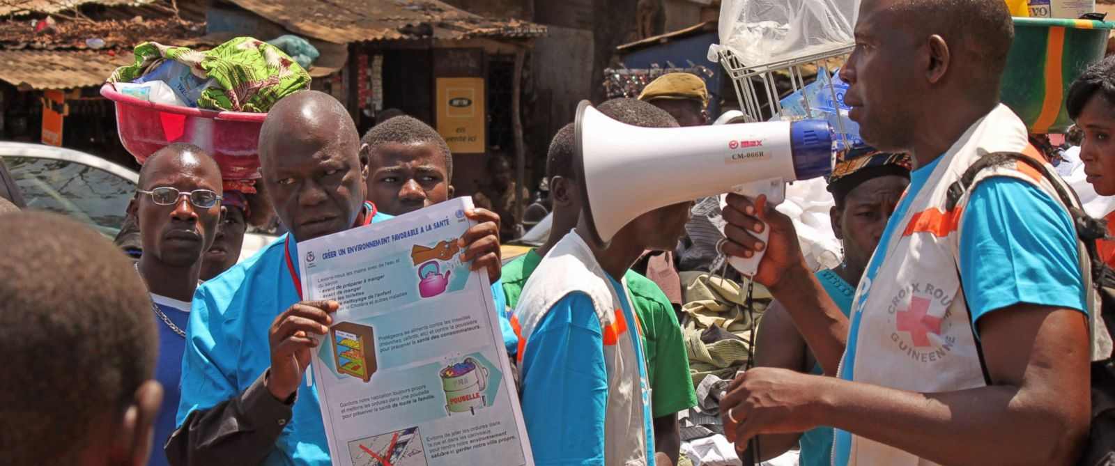 PHOTO: Health workers teach people about the Ebola virus and how to prevent infection, in Conakry, Guinea, March 31, 2014.