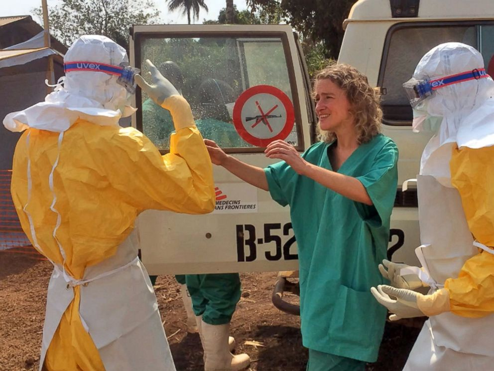 PHOTO: Healthcare workers from the organization Medecins Sans Frontieres (Doctors without Borders), prepare isolation and treatment areas for their Ebola, hemorrhagic fever operations, in Gueckedou, Guinea, March 28, 2014.