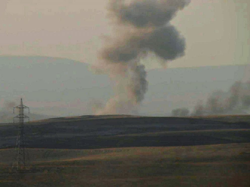 PHOTO: This image made from AP video shows smoke rising from airstrikes targeting Islamic State militants near the Khazer checkpoint outside of the city of Erbil in northern Iraq, Aug. 8, 2014.