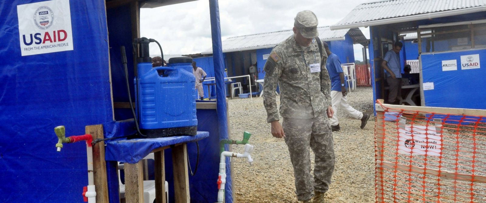 PHOTO: A member of the U.S army walks past a newly constructed Ebola treatment centre in Bongcounty, on the outskirts of Monrovia, Liberia, Oct. 7, 2014.