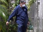 PHOTO: An inspector with the Miami- Dade County mosquito control unit, sprays pesticide in the yard of a home, April 12, 2016, in Miami, Florida. The NIH holds a briefing on the Zika Virus, May 3, 2016.