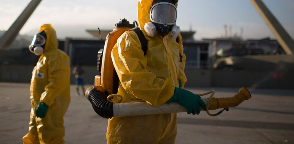 PHOTO: Health workers stand in the Sambadrome spraying insecticide to combat the Aedes aegypti mosquito that transmits the Zika virus in Rio de Janeiro, Jan. 26, 2016.