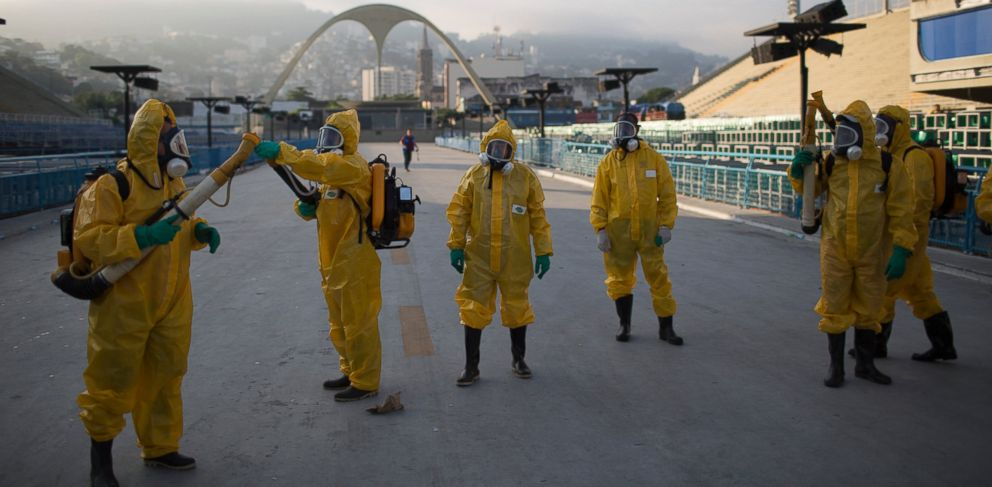 PHOTO:Health workers spray insecticide to combat the Aedes aegypti mosquitoes that transmits the Zika virus under the bleachers of the Sambadrome in Rio de Janeiro, which will be used for the Archery competition in the 2016 summer games.