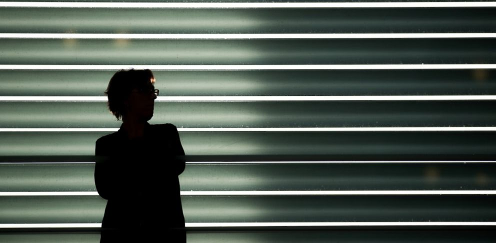 PHOTO: A woman silhouetted in front of a large window in Berlin, Germany.