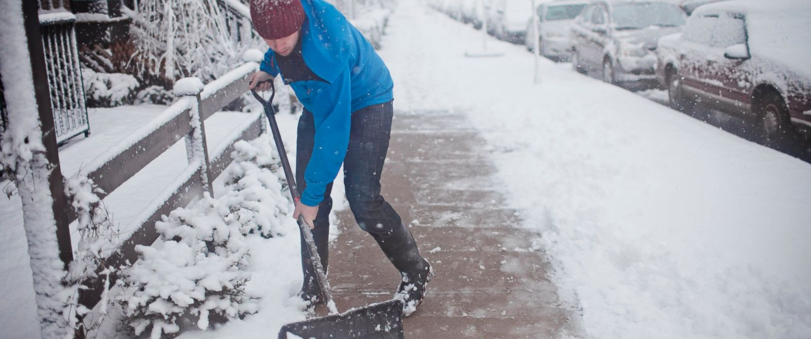 PHOTO: A man shovels the sidewalk.