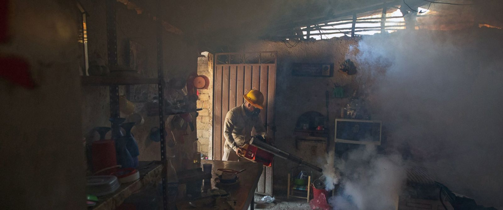PHOTO: An employee of the Health Secretariat fumigates a home against the Aedes aegypti mosquito to prevent the spread of the Zika, Virus in Acapulco, Mexico, Feb. 2, 2016.