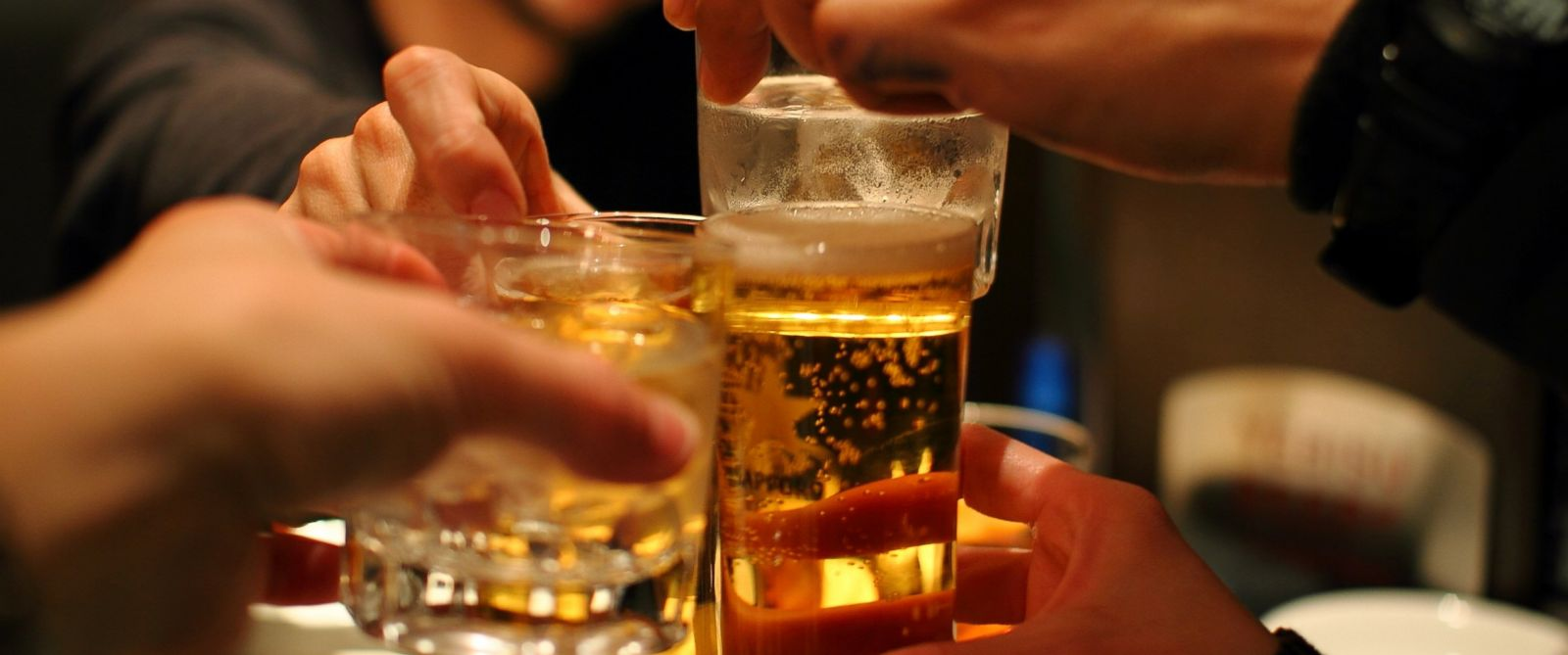 PHOTO: Friends drink whiskey and beer in this stock photo.