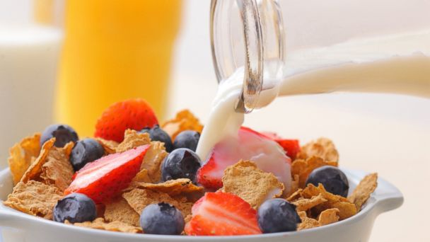PHOTO: Milk being poured onto cereal.