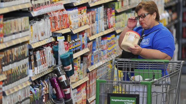 PHOTO: A shopper reads the label on a package of non-dairy creamer at a Walmart Neighborhood Market in Panorama City, Calif., Sept. 28, 2012.