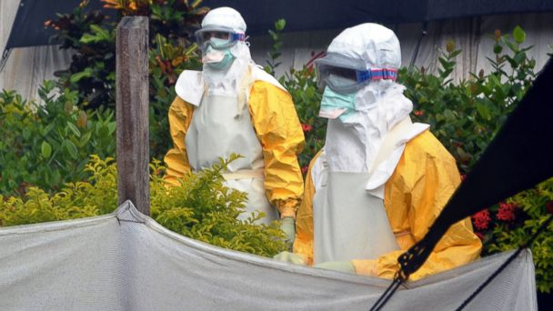 PHOTO: Members of Doctors Without Borders are pictured wearing protective gear outside an isolation ward of the Donka Hospital on July 23, 2014 in Conakry, Guinea.