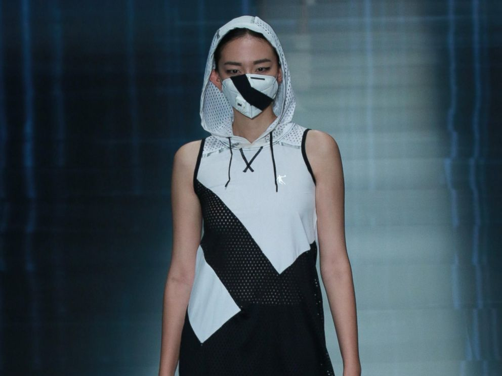 China 39 s smog prompts face masks on fashion week runways abc news Healing with style fashion show