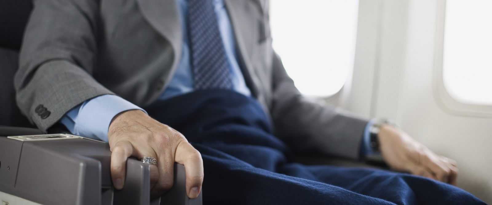 PHOTO: A nervous passenger grabs the armrest of his seat during a flight in this stock photo.
