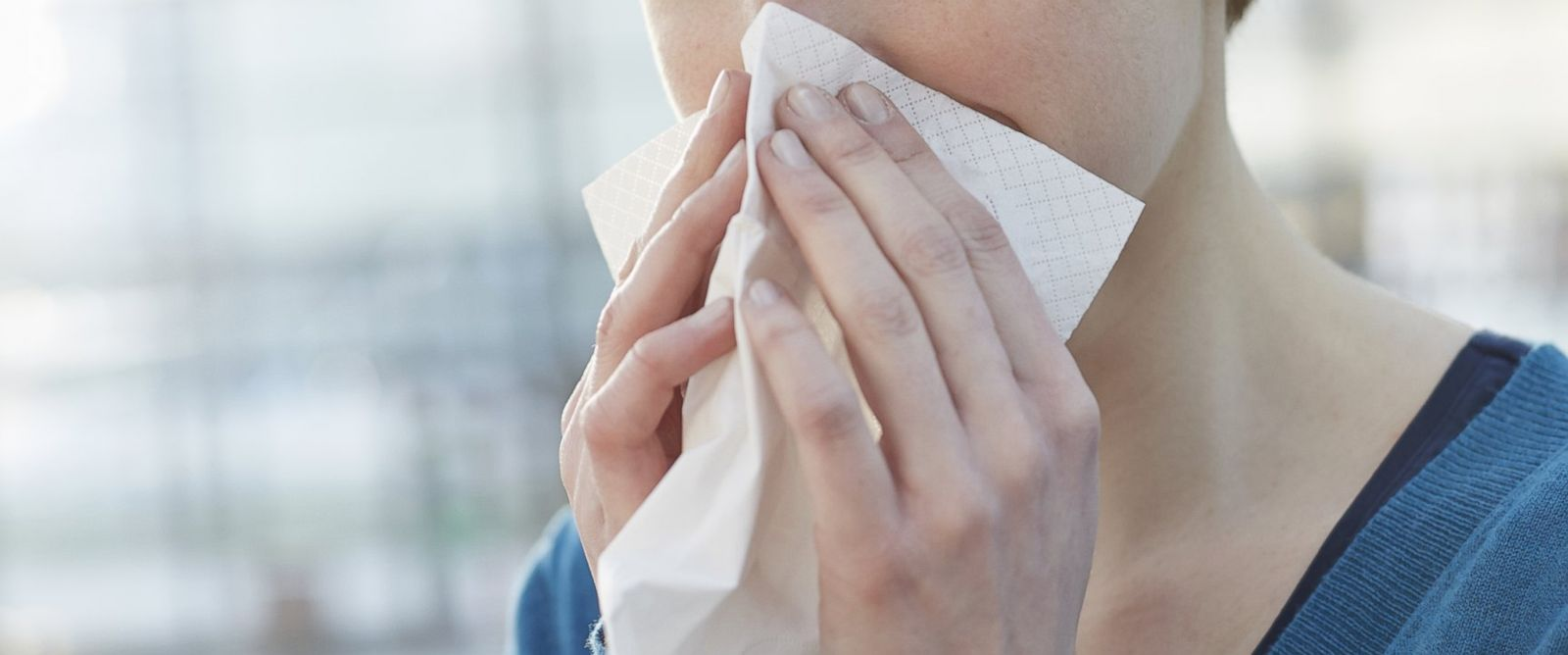 PHOTO: A woman blowing her nose is pictured in this stock photo.