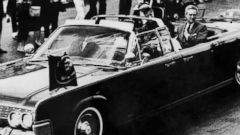 PHOTO: The presidential motorcade travels through Dallas a few moments before John F Kennedy was shot.