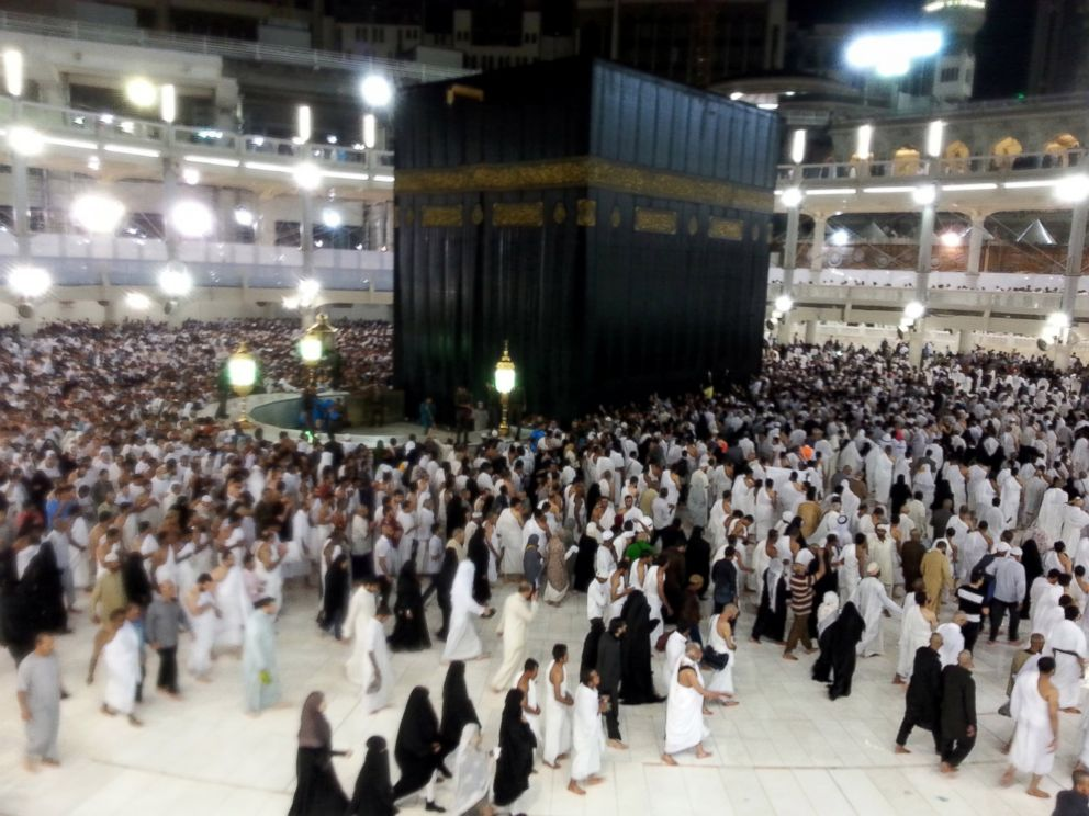 PHOTO: Muslim pilgrims circle counterclockwise Islams holiest shrine, the Kaaba, in the Grand Mosque in the Muslim holy city of Mecca under the heavy rain in Saudi Arabia on May 8, 2014.