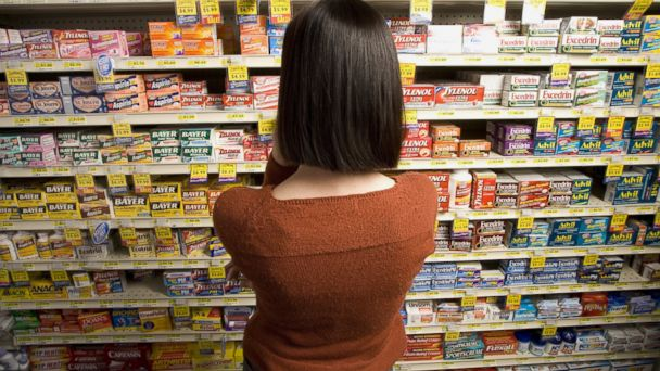 PHOTO: A woman browses for medicine at a pharmacy.