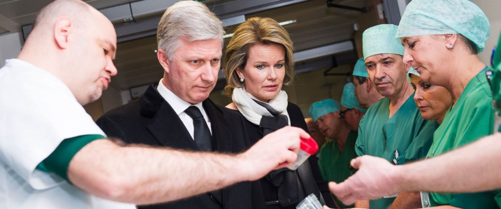 PHOTO: King Philippe and Queen Mathilde of Belgium look at fragments of iron shrapnel from a nail bomb at the Campus Gasthuisberg UZ hospital in Leuven, outside Brussels, March 24, 2016.