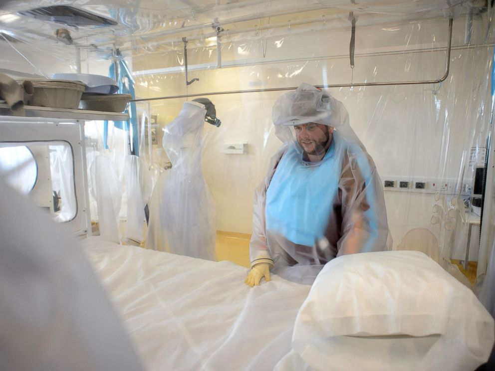 PHOTO: A nurse wears protective clothing as he demonstrates the facilities in place at the Royal Free Hospital in north London, Aug. 6, 2014, in preparation for a patient testing positive for the Ebola virus.