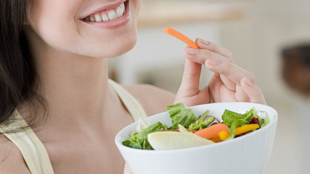 PHOTO: In this stock image, a woman is pictured eating a salad.