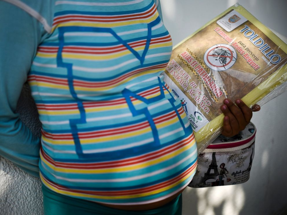 PHOTO:A pregnant woman holds a mosquito net in Cali, Columbia, Feb. 10, 2016. The Colombian Health Ministry began delivering mosquito nets for free to pregnant women to prevent the infection by Zika virus.