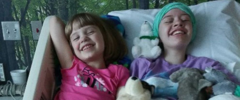 PHOTO: Abigail Kopfs family posted a picture of her smiling with her sister as she recovers.