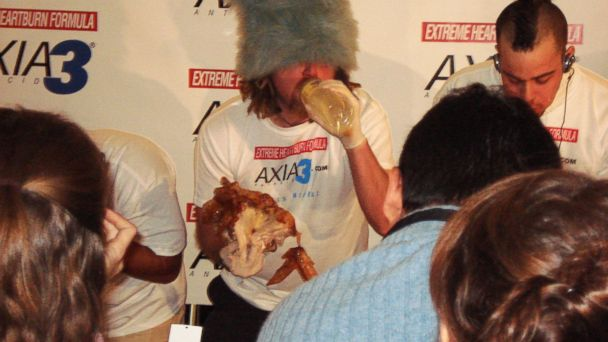 PHOTO: Competitive eater Crazy Legs Conti attempting to eat 9 pounds of turkey in 12 minutes.