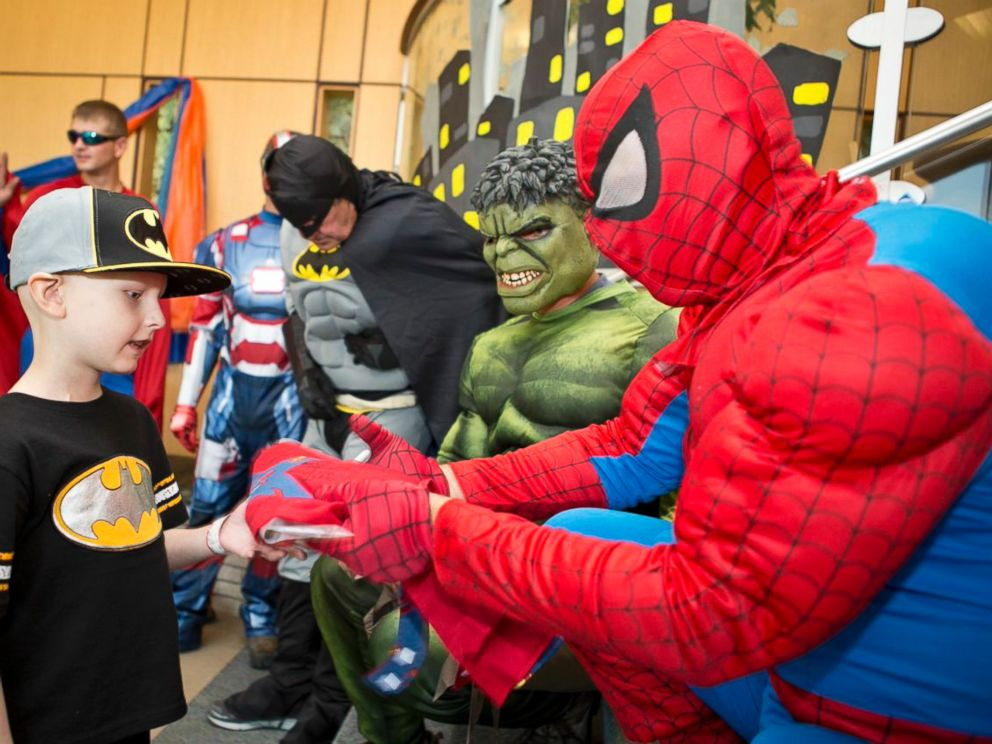PHOTO: John Carroll, 48, ordered the costumes for the window-washing team. He got to be Spiderman.